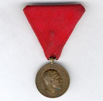 "Medal for Merit, Type I, in Bronze (with older portrait and stamped ""SCHWENZER"") Obverse"