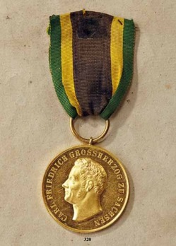 "Merit Medal, Type II, in Gold (stamped ""AF"")"