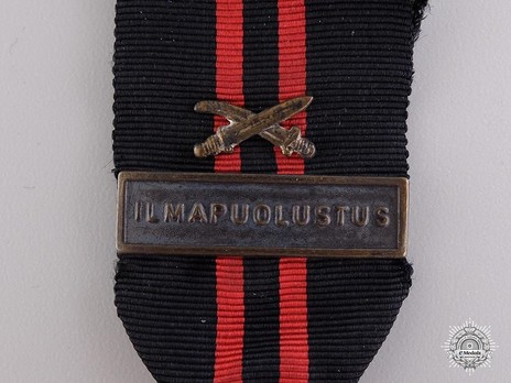 "Winter War Medal, Type II (with clasp ""ILMAPUOLUSTUS"") Detail"