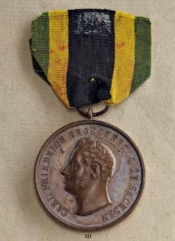 "Merit Medal, Type II, in Bronze (stamped ""AF"")"