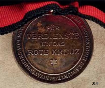 "Karl-Olga Medal for Merit in the Red Cross, in Silver (stamped ""SCHWENZER"")"