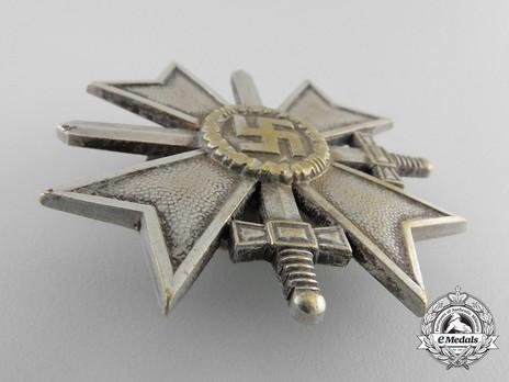 War Merit Cross I Class with Swords, by C. E. Juncker (L/12, tombac, screwback) Obverse