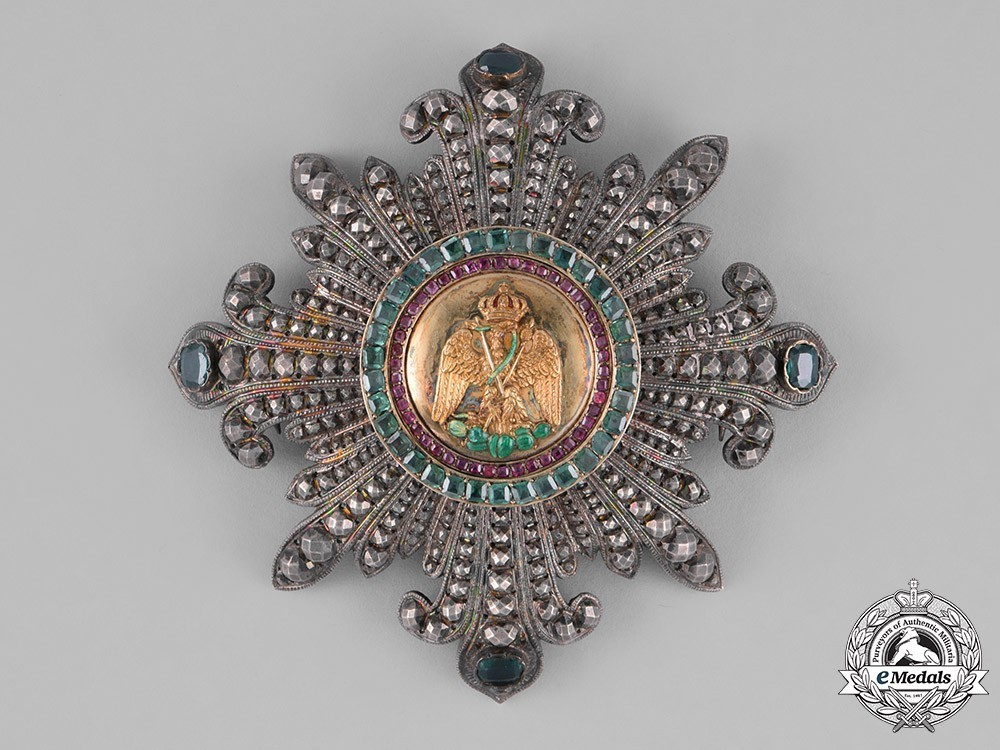 Grand+cross+breast+star+by+halley+emeralds+and+rubies%2c+obverse