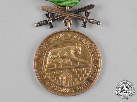 Order of Albert the Bear, Gold Medal of Merit with Swords (in bronze gilt) Obverse