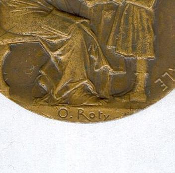"""Bronze Medal (stamped """"O.ROTY"""") Detail"""