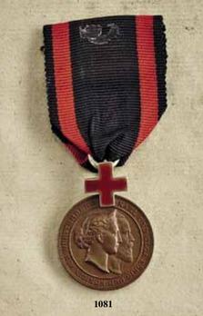 "Karl-Olga Medal for Merit in the Red Cross, in Bronze (stamped ""SCHWENZER"")"