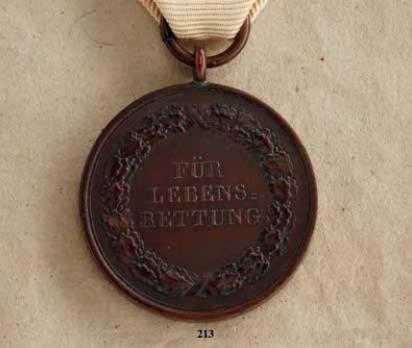 "Life Saving Medal, Type IV, in Bronze (stamped ""M.BALDURECK FEC."")"