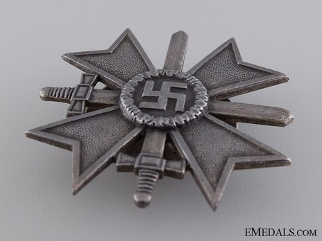 War Merit Cross I Class with Swords, by P. Meybauer (L/13, tombac, screwback) Obverse