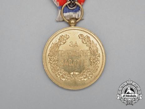 1902 Civil Merit Medal, in Gold (stamped HUGUENIN) Reverse