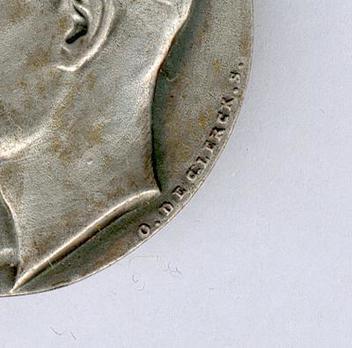 """Silver Medal (stamped """"'E. GOERGEN P."""" """"O. DE CLERCK.S."""") Obverse Detail"""